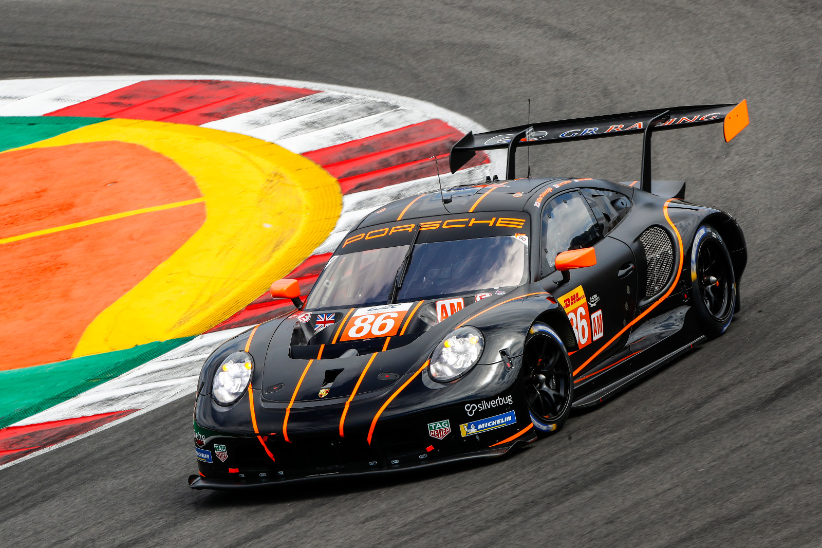 GR Racing Porsche RSR rounding a bend at 8 Hours of Portimao 2021
